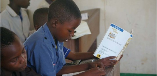 Test scores rise as schools are rebuilt and books are provided