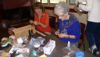 Lafayette-Orinda California team hard at work making necklaces for a craft fair