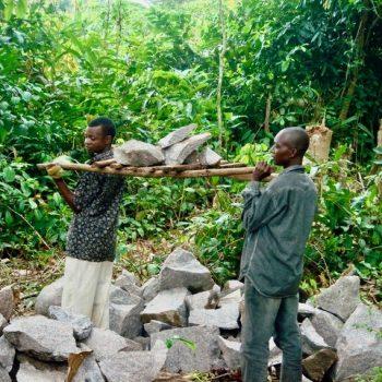 Men find stones for foundation