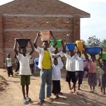 Students bring water for concrete